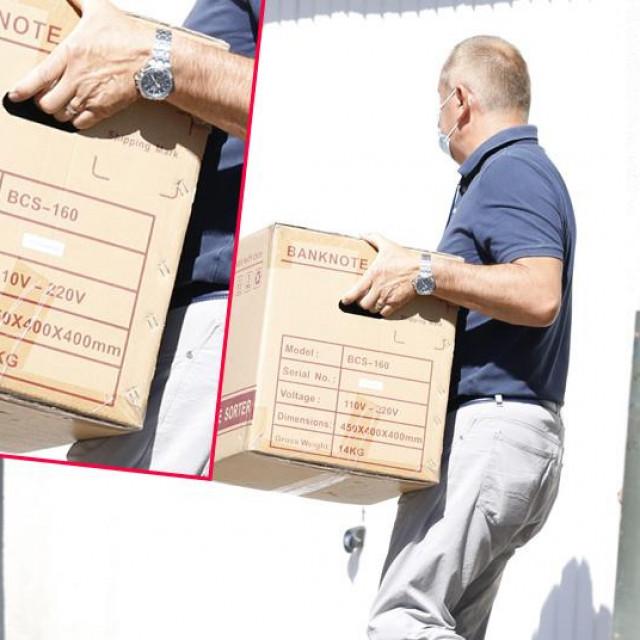 Kutija u kojoj su iznošeni dokazi iz kuće Kazimira Bačića, ravnatelja HRT-a