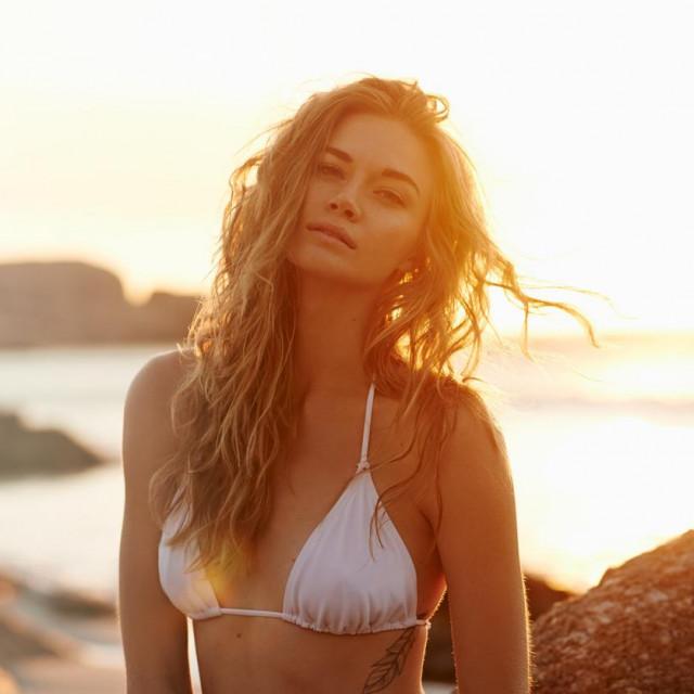 Portrait of a beautiful young woman in a bikini on the beach