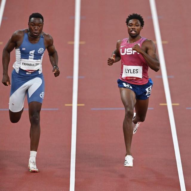 Joseph Fahnbulleh iz Liberije (lijevo) i Noah Lyles iz SAD-a (desno)
