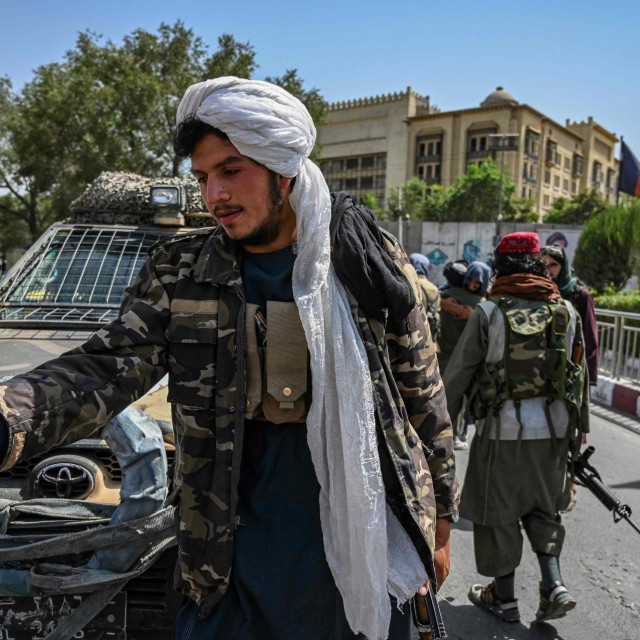 Taliban fighters stand guard along a street at the Massoud Square in Kabul on August 16, 2021. (Photo by Wakil Kohsar/AFP)