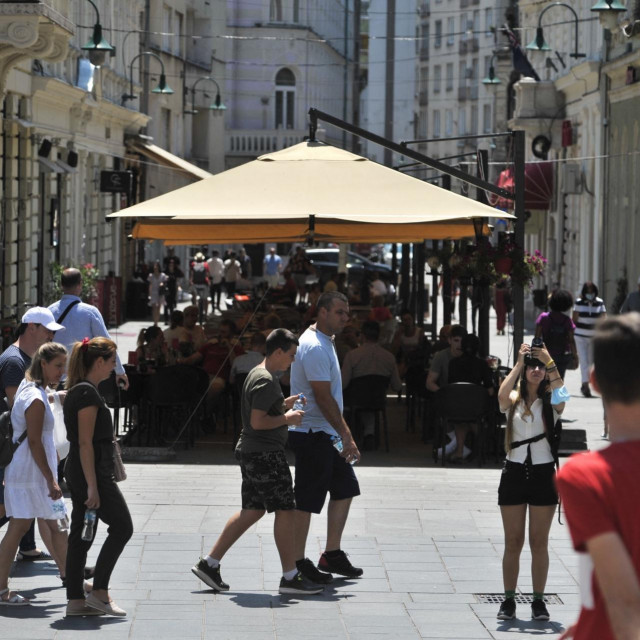 SARAJEVO, BOSNIA AND HERZEGOVINA - JULY 24: People walk around at a street after the removal of many pandemic measures in the country, in Sarajevo, Bosnia and Herzegovina on July 24, 2021. Many countries in Europe, where the number of novel coronavirus (Covid-19) cases increased again, the measures and restrictions taken within the scope of combating the pandemic are being toughened. In Bosnia and Herzegovina, where vaccine supply and vaccinations were delayed, only 5 percent of the population was vaccinated. With the removal of many restrictions and measures in the country, streets returned to their pre-pandemic condition. Samir Jordamovic/Anadolu Agency (Photo by Samir Jordamovic/ANADOLU AGENCY/Anadolu Agency via AFP)