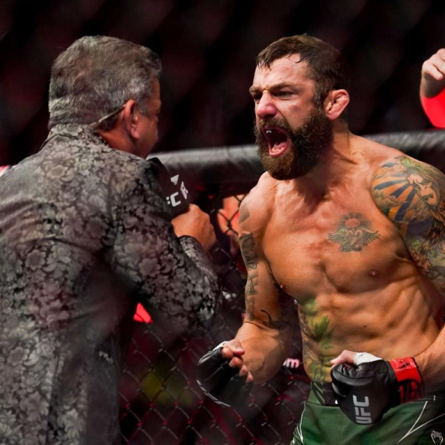 HOUSTON, TX - AUGUST 07: Michael Chiesa is introduced by Bruce Buffer before his bantamweight fight against Vincente Luque at Toyota Center on July 7, 2021 in Houston, Texas. Alex Bierens de Haan/Getty Images /AFP,Image: 626037492, License: Rights-managed, Restrictions:, Model Release: no, Credit line: Alex Bierens de Haan/Getty images/Profimedia