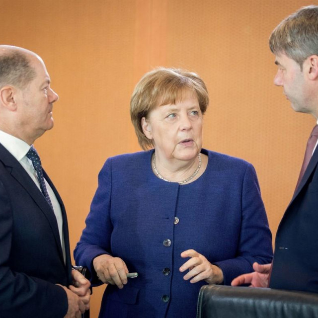Angela Merkel i Jan Hecker (desno na fotografiji)