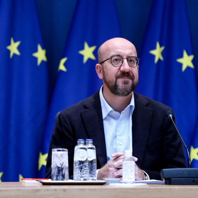 European Council President Charles Michel looks on as he attends a video conference at the European Council building in Brussels on October 1, 2021. (Photo by Kenzo TRIBOUILLARD/POOL/AFP)