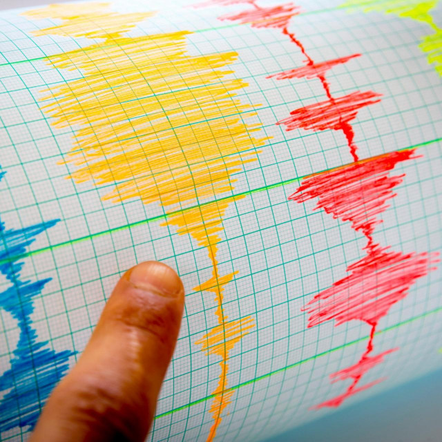 Seismological device for measuring earthquakes. Seismological activity lines on the sheet of measuring paper. Earthquake wave on graph paper. Vignette image. Human finger showing a detail.,Image: 299915020, License: Royalty-free, Restrictions:, Model Release: no, Credit line: Pluto/Alamy/Alamy/Profimedia