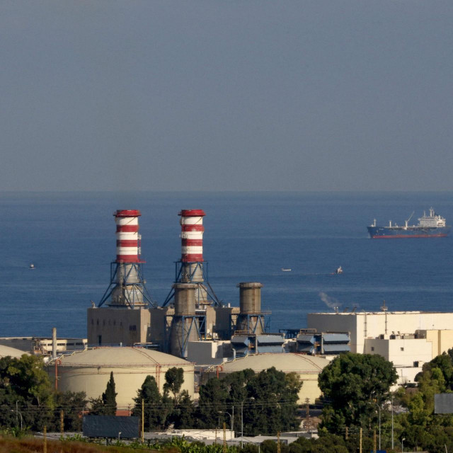 (FILES) In this file photo taken on September 18, 2021, an oil tanker carrying fuel oil from Iraq, is seen anchored near the Zahrani power plant in Zahrani near the southern Lebanese city of Sidon (Saida). - Lebanon was plunged into a total blackout today after two main power stations went offline because they ran out of fuel, the state electricity corporation said. (Photo by Mahmoud ZAYYAT/AFP)
